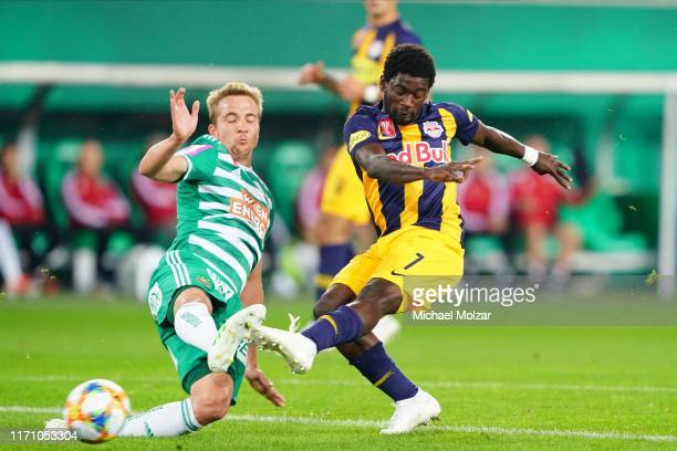 Sekou Koita of Salzburg shoots at goal attacked by Christopher Dibon of Rapid during the OeFB cup match between SK Rapid Wien and FC Red Bull...