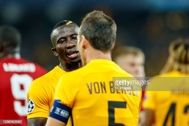 Sekou Sanogo of BSC Young Boys speaks with Steve von Bergen of BSC Young Boys during the UEFA Champions League Group H match between BSC Young Boys...