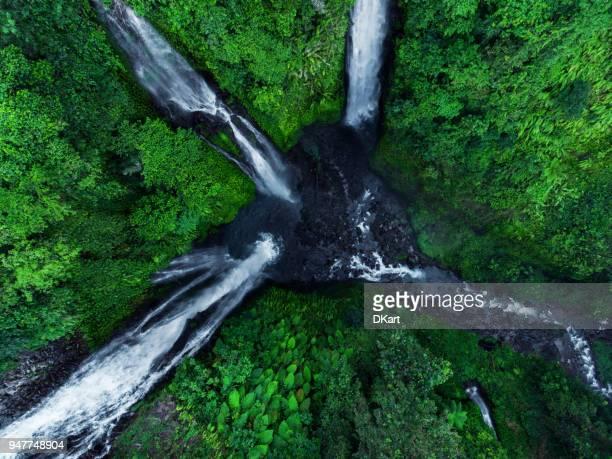 sekumpul waterfalls in bali, indonesia - scorrere foto e immagini stock