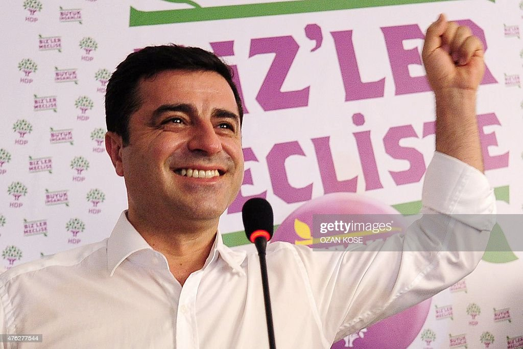 Selahattin Demirtas, co-chair of the pro-Kurdish People's Democratic Party (HDP), gestures during a press conference in Istanbul on June 7, 2015. Turkey's Islamic-rooted ruling party lost its absolute parliamentary majority in legislative elections, dealing a severe blow to strongman President Recep Tayyip Erdogan's ambition to expand his powers. In a sensational result that shakes-up Turkey's political landscape, the pro-Kurdish People's Democratic Party (HDP) easily surpassed the 10 percent barrier needed to send MPs to parliament.