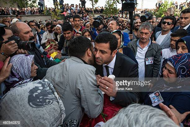 Selahattin Demirtas leader of the pro Kurdish Democratic Party of Peoples attends the funeral of one of the victims of Saturday's bombing attacks on...