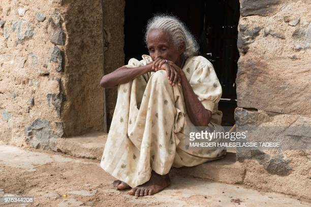 Selasse Gebremeskel sits at the entrance of her home in Badme a disputed town on the border between Ethiopia and Eritrea on June 14 2018 If...