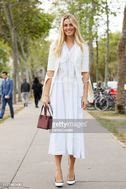 Selby Drummond wearing white lacey dress and mini brown bag outside Loewe during Paris Fashion Week - Womenswear Spring Summer 2020 on September 27,...