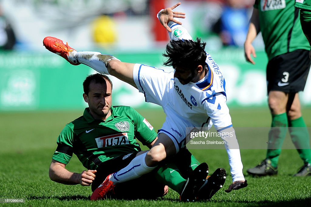 Selcuk Alibaz (R) of Karlsruhe and Patrick Kirsch (L) of Muenster battle for the ball during the 3. Liga match between Preussen Muenster and Karlsruher SC at Preussenstadion on April 20, 2013 in Muenster, Germany.