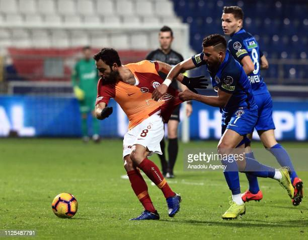 Selcuk Inan of Galatasaray in action against Trezeguet of Kasimpasa during the Turkish Super Lig soccer match between Kasimpasa and Galatasaray at...