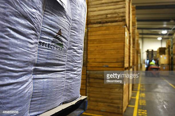 A Select Harvest Ltd logo is seen on a bag near crates of almonds at the company's plant near Wemen Victoria Australia on Wednesday Sept 23 2015 Bees...