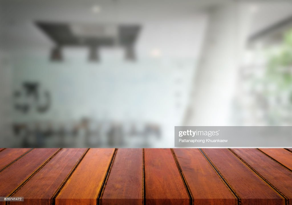 Selected Focus Empty Brown Wooden Table And Meeting Room Or Office Work Blur Background Image