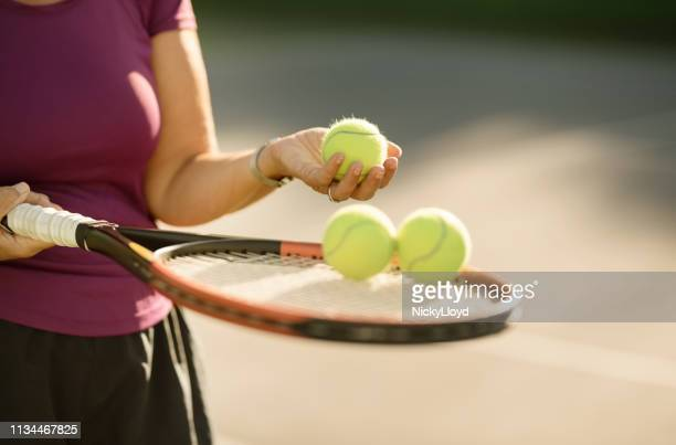 selecting a ball for service - tennis player stock pictures, royalty-free photos & images