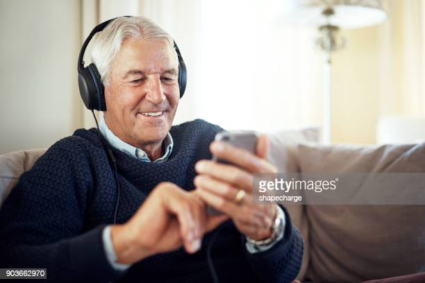 selecting some great tunes to relax to - mp3 player stock pictures, royalty-free photos & images