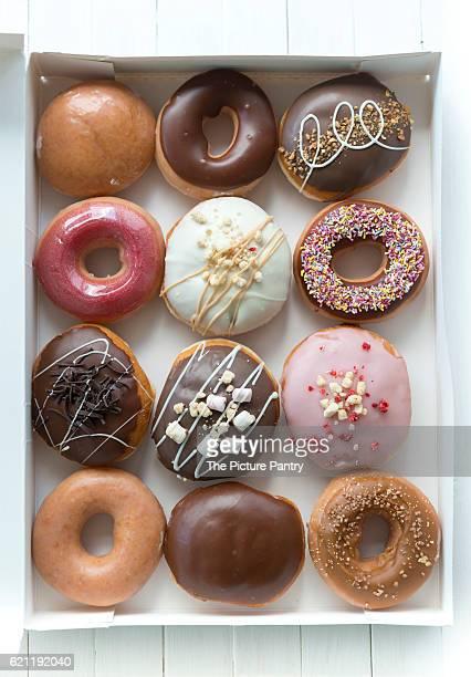 A selection box of a dozen donuts.