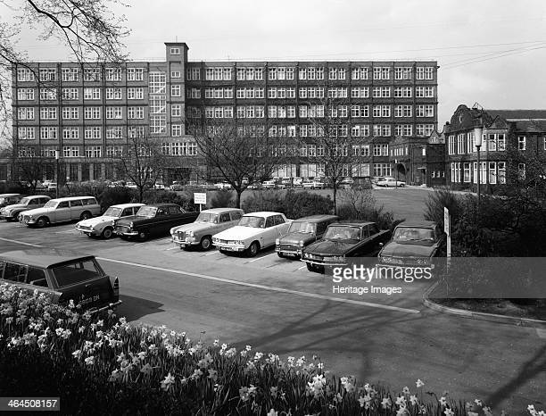 A selection of 1960s cars in a car park York North Yorkshire May 1969 Amongst the cars are two Rover 2000cc saloons a Mini Estate a Wolseley 16/60 a...