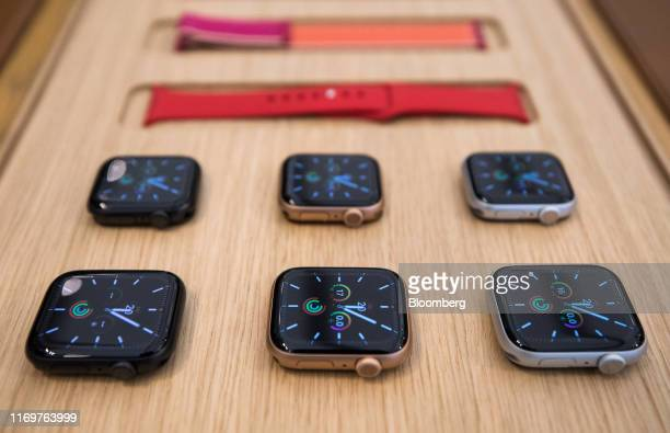 Selection of Apple Inc. Watch Series 5 smartwatch devices sit on display inside the Regent Street Apple store during a product launch event in...