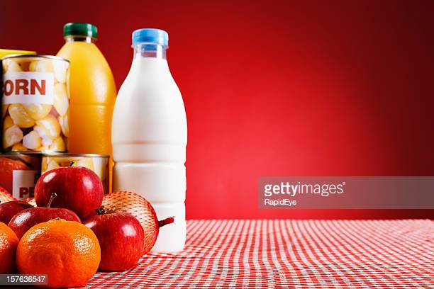 selection of basic fresh and packaged foods against red - generic description stock pictures, royalty-free photos & images