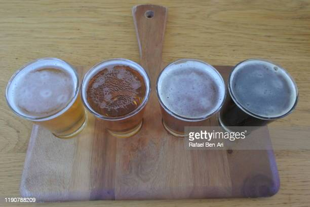 selection of beer tasting samples - rafael ben ari stock pictures, royalty-free photos & images