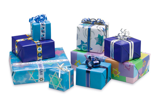 Selection of blue wrapped Hanukkah gifts isolated on white 146882334