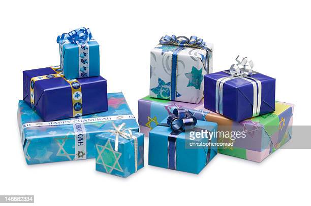 selection of blue wrapped hanukkah gifts isolated on white - hanukkah stock pictures, royalty-free photos & images