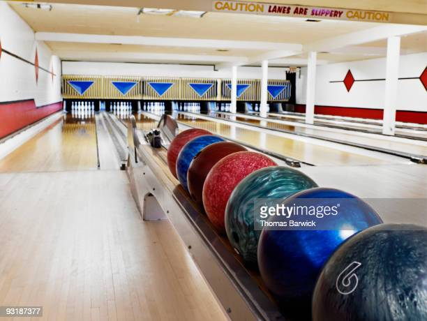 Selection of bowling balls in bowling alley