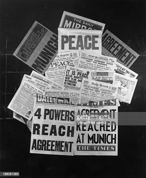 Selection of British newspaper front pages, published on 30th September 1938 and headlining the Munich Agreement, signed by Nazi Germany, France, the...