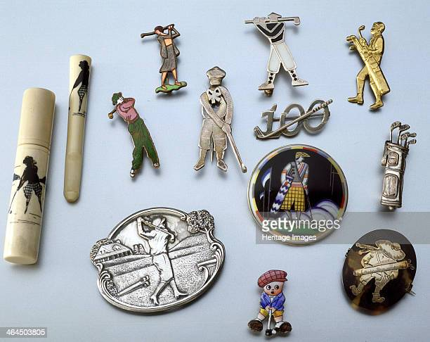 Selection of brooches lady's cigarette holder in case bone and handpainted sihoute c1915 enamel man and woman golfers c1930 silver and motherofpearl...