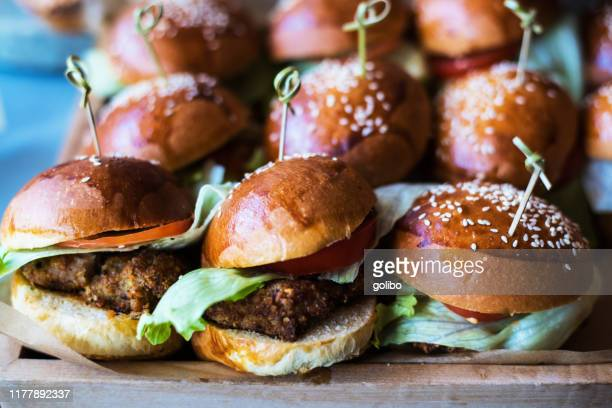 a selection of burgers in a small delicatessen - brioche stock pictures, royalty-free photos & images