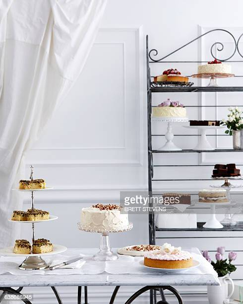 Selection of cakes on traditional tea table and stand