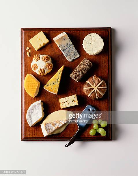 Selection of cheeses on cheeseboard, overhead view
