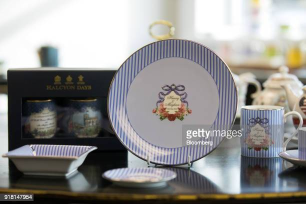 A selection of china teaware to commemorate the wedding between Henry Windsor and Meghan Markle stands on display at Halcyon Days Ltd's factory in...