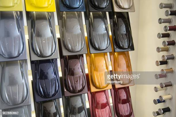 A selection of color samples for exterior body work are displayed at an Aston Martin Lagonda Ltd showroom in Singapore on Tuesday Sept 19 2017 Aston...