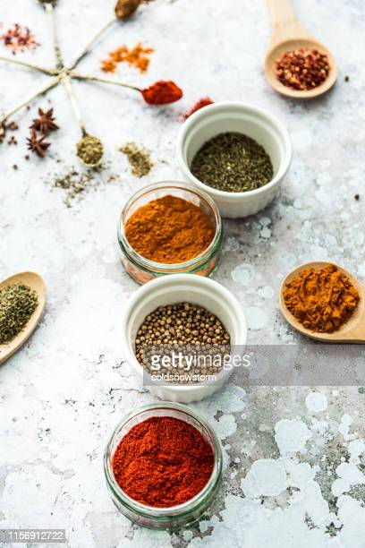 selection of colorful fresh herbs and spices - spice stock pictures, royalty-free photos & images