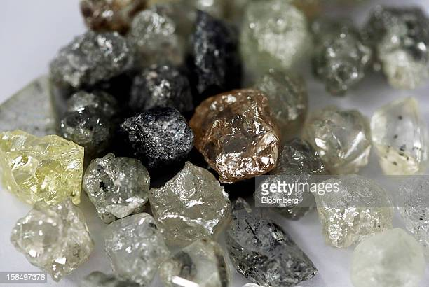 A selection of colorless and colored uncut diamonds sit on a sorting table at DTC Botswana a unit of De Beers in Gaborone Botswana on Thursday Oct 25...