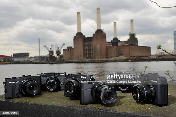 A selection of compact digital cameras Olympus Stylus XZ2 Fujifilm X20 Pro Nikon COOLPIX PP7700 Sony RX100 Panasonic Lumix DMCLX7 and Canon Powershot...
