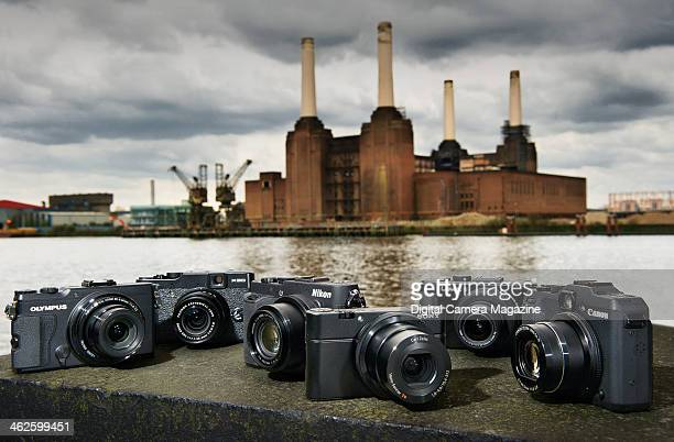 A selection of compact system cameras photographed in front of Battersea Power Station in London for a feature on powerful digital compacts taken on...