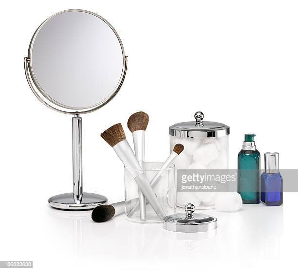 Selection of cosmetic items on white background
