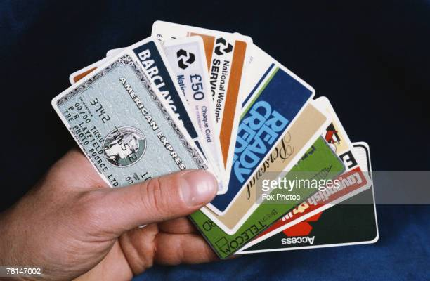 A selection of credit and bank cards along with a green British Telecom phone card 1986