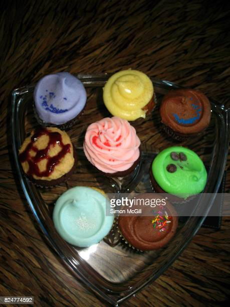 Selection of cupcakes in various flavours and different coloured icing