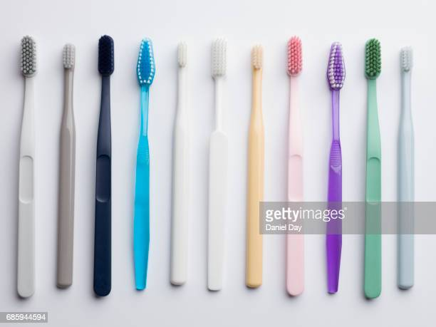 Selection of different colour plastic toothbrushes