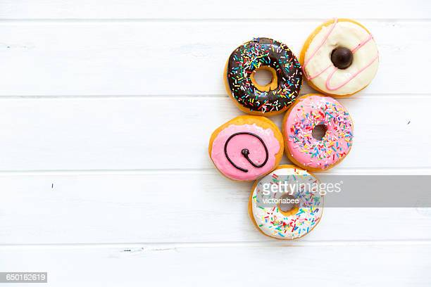 Selection of donuts with multi-colored icing