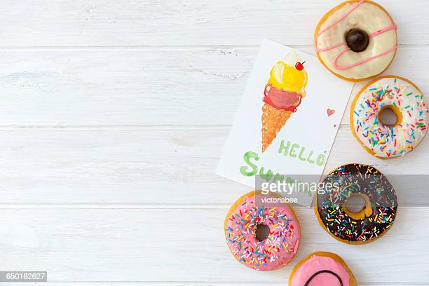 Selection of donuts with multi-colored icing with note