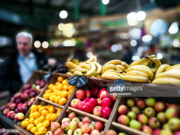 selection of exotic and fresh fruit on display at borough market, london, uk - borough market stock photos and pictures