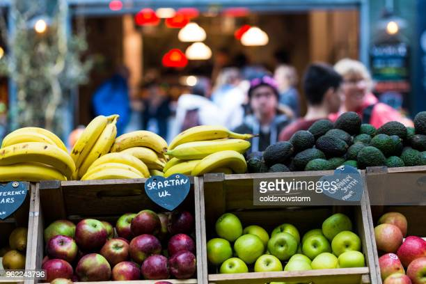 selection of exotic and fresh fruit on display at borough market, london, uk - bancarella di verdura foto e immagini stock