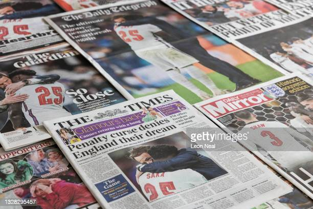 Selection of front pages from UK daily national newspapers featuring fallout from England's loss to Italy in the final of the Euro 2020 football...