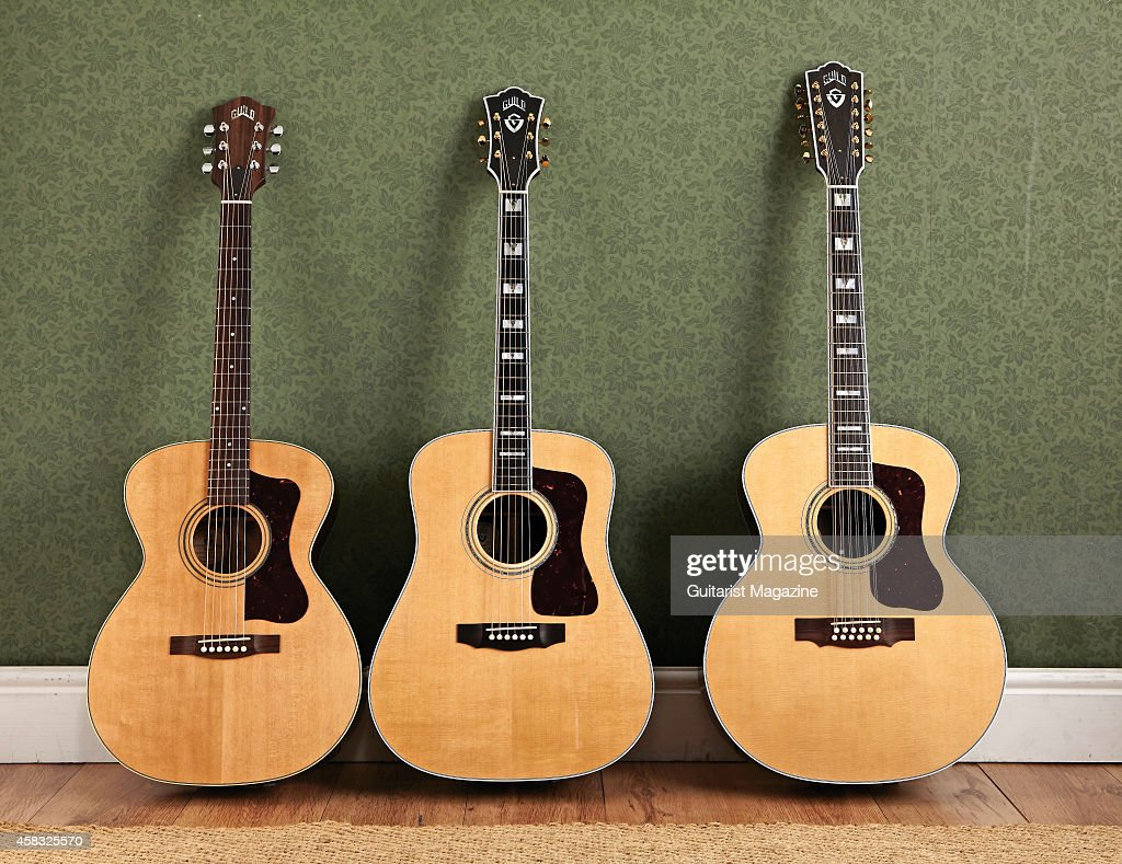 A selection of Guild acoustic guitars, including a Guild F