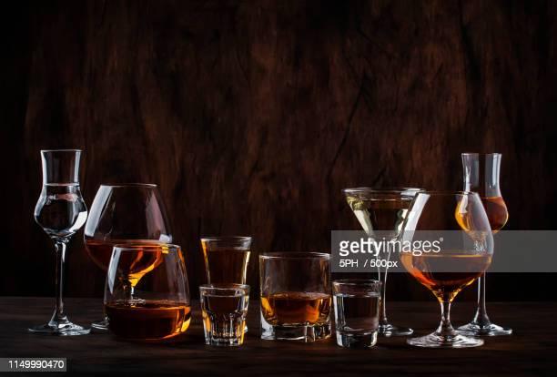 selection of hard strong alcoholic drinks in big glasses and sma - bebida destilada - fotografias e filmes do acervo