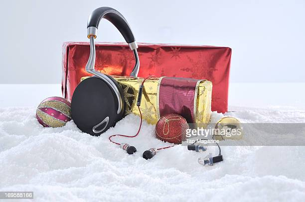 A selection of headphones for Apple iOS devices including sets of Parrot Zik Atomic Floyd Superdarts Remote and Etymotic HF3 photographed during a...