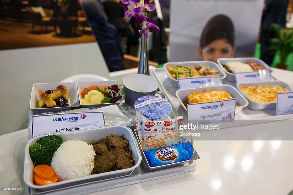 A selection of in-flight meals for Malaysia Airline System Bhd. are seen on display during the ITB Berlin tourism fair at Messe Berlin exhibition center in Berlin, Germany, on Wednesday, March 5, 2014. Archaic rules, taxes as high as those imposed on alcohol and an infrastructure deficit, especially in Asia, are curbing the aviation industry's growth, the International Air Transport Association said. Photographer: Krisztian Bocsi/Bloomberg via Getty Images