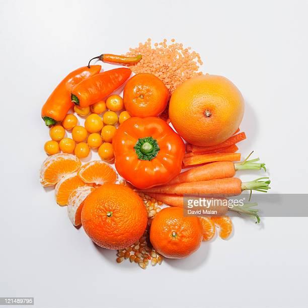 A selection of orange fruits & vegetables.
