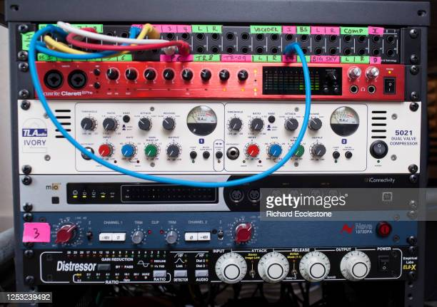 Selection of outboard rack mounted sound processing equipment in a recording studio being used by Mark Wilkinson English record producer DJ and...