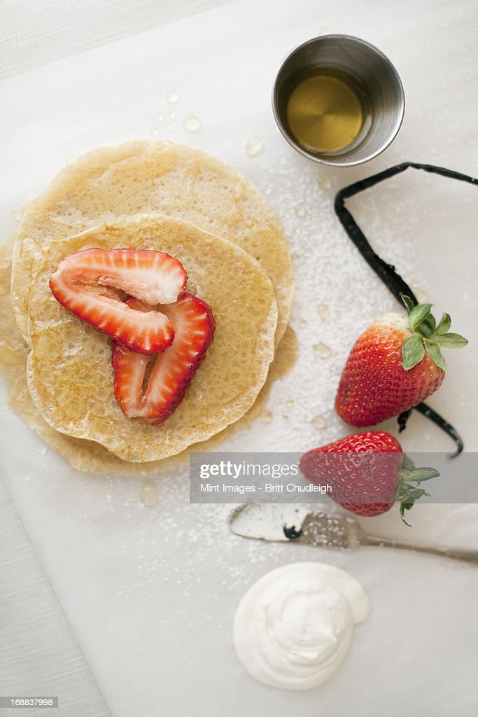 A selection of party desserts. Pancakes, freshly cooked, with strawberries and a drink. Organic food. : Stock Photo