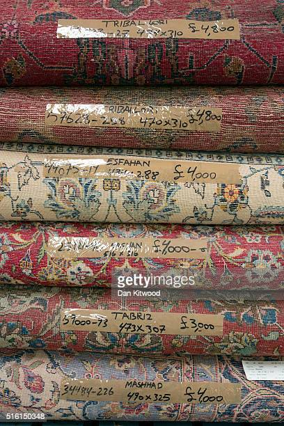A selection of Persian rugs are piled at the Oriental Rug Centre's main warehouse on March 17 2016 in London England The Oriental Rug Centre in North...