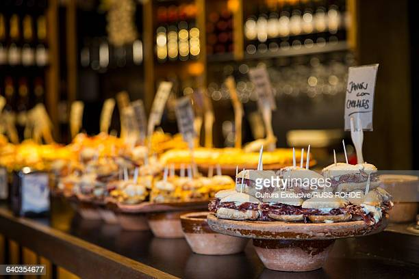 Selection of pintxos tapas on restaurant counter. Bilbao, Spain